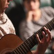 Young Musician Plays His Acoustic Guitar as Friend Listens — Stock Photo