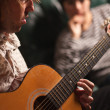 Young Musician Plays His Acoustic Guitar as Friend Listens - Zdjęcie stockowe