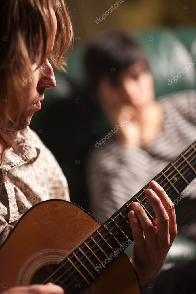 Young Musician Plays His Acoustic Guitar as Friend in the Background Listens. — Stock Photo #4009616