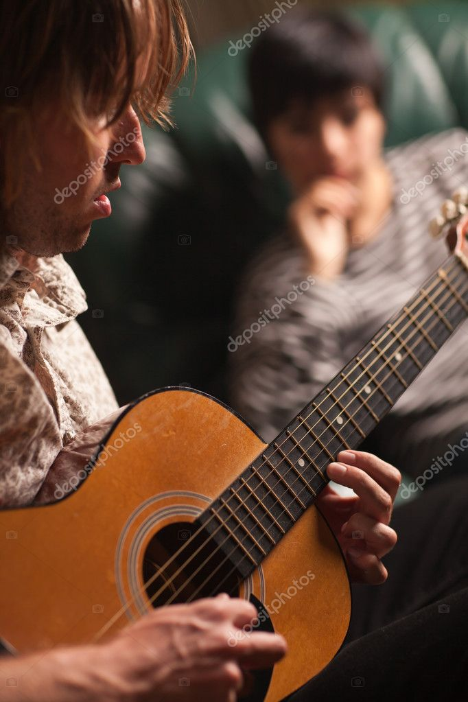 Young Musician Plays His Acoustic Guitar as Friend in the Background Listens. — Stock Photo #4009621