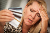 Upset Woman Holding Her Many Credit Cards — Stock Photo