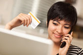 Multiethnic Woman Holding Phone and Credit Card Using Laptop — Stock Photo