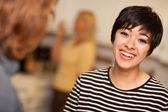 Laughing Young Woman Socializing — Stock Photo