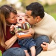 Stock Photo: Happy Mixed Race Parents Playing with Their Son