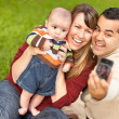 Happy Mixed Race Parents and Baby Boy Taking Self Portraits — Stock Photo #4116629
