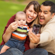 Stock Photo: Happy Mixed Race Parents and Baby Boy Taking Self Portraits
