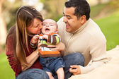 Happy Mixed Race Parents Playing with Their Son — Stock Photo