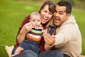 Happy Mixed Race Parents and Baby Boy Taking Self Portraits — Stock Photo