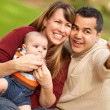 Happy Mixed Race Parents and Baby Boy Taking Self Portraits — Stock Photo #4181456