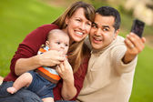 Happy Mixed Race Parents and Baby Boy Taking Self Portraits — Zdjęcie stockowe