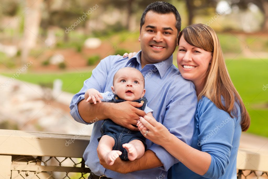 Happy Mixed Race Family Posing for A Portrait in the Park. — Stock Photo #4181421