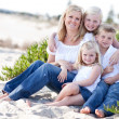 Royalty-Free Stock Photo: Attractive Mom and Her Cute Children at The Beach