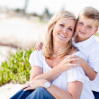 Cute Son Hugs His Mom at The Beach — Stock fotografie #4231435