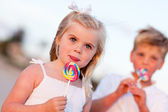 Cute Little Girl and Brother Enjoying Their Lollipops — Stock Photo
