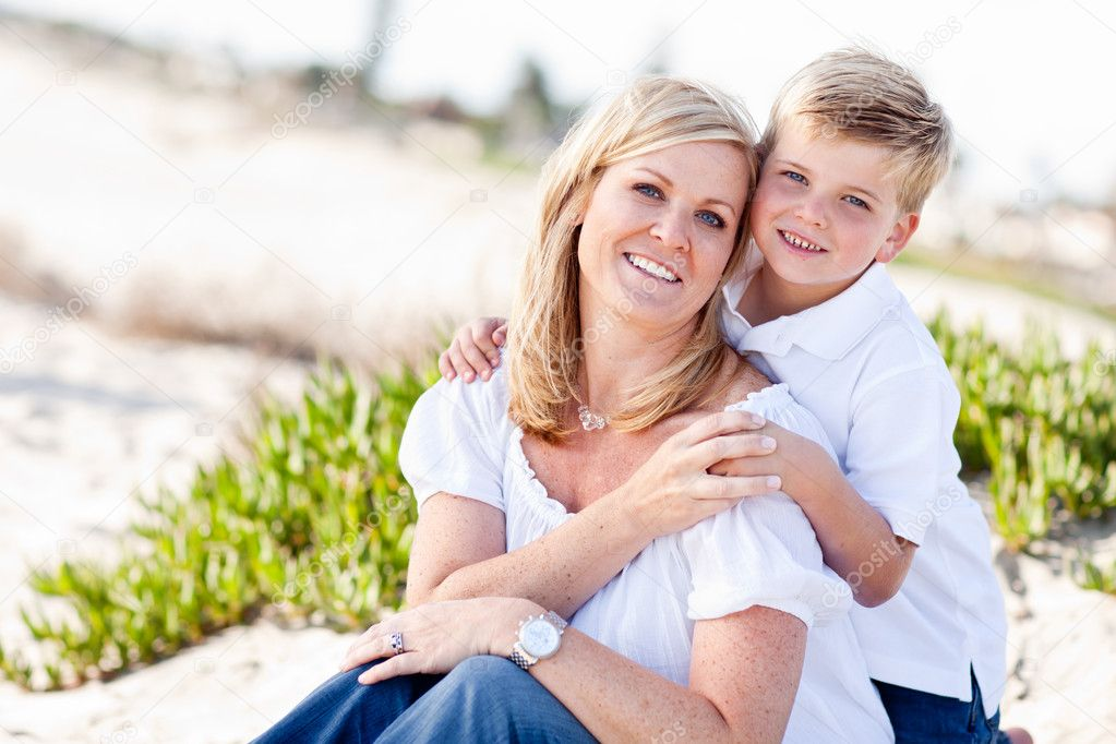 Cute Son Hugs His Attractive Mom Portrait at The Beach. — Zdjęcie stockowe #4231435