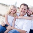 Handsome Dad and His Cute Daughters at The Beach — Stock Photo #4251756