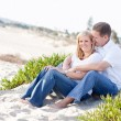 Attractive Caucasian Couple Relaxing at the Beach — Stock Photo #4251770