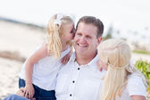 Handsome Dad Getting Kisses from His Cute Daughters — Stockfoto