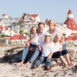Stock Photo: Happy Caucasian Family in Front of Hotel Del Coronado