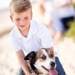 Handsome Young Boy Playing with His Dog — Stock Photo