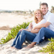 Attractive Caucasian Couple Relaxing at the Beach — Foto de Stock
