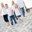 Stock Photo: Adorable Little Girl Leads Her Family on a Walk