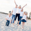 Stock Photo: Happy Sibling Children Jumping for Joy