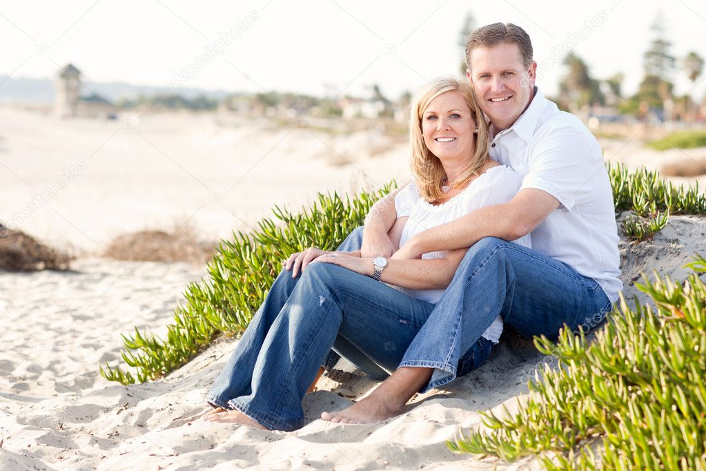 Attractive Caucasian Couple Relaxing and Enjoying the Beach Together. — Stock Photo #4280926