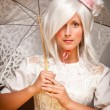 Pretty White Haired Woman with Parasol and Classic Dress - Stock Photo