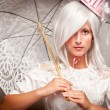 Pretty White Haired Woman with Parasol - Stock Photo