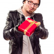 Warmly Dressed Young MHanding Wrapped Gift Out — Stock Photo #4323557