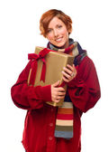 Pretty Red Haired Girl with Scarf Holding Wrapped Gift — Stock Photo