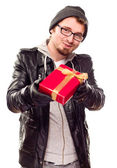 Warmly Dressed Young Man Handing Wrapped Gift Out — Stock Photo