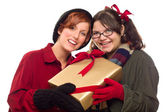 Two Pretty Girlfriends Holding A Holiday Gift — Stock Photo