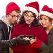Three Friends Enjoying A Cell Phone Together — Stockfoto #4337886