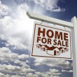 Stock Photo: White Home For Sale Real Estate Sign Over Clouds and Sky