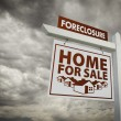 Royalty-Free Stock Photo: White Foreclosure Home For Sale Real Estate Sign Over Cloudy Sky
