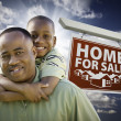 African American Father with Son In Front of Real Estate Sign — Stock Photo