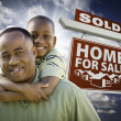 African American Father with Son In Front of Sold Home For Sale — Stock Photo