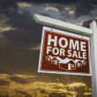 Stock Photo: Red Home For Sale Real Estate Sign Over Sunset Sky