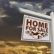 Stock Photo: White Home For Sale Real Estate Sign Over Sunset Sky