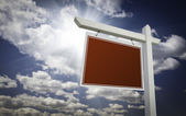 Blank Red Real Estate Sign Over Sky — Stock Photo