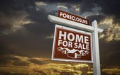 Red Foreclosure Home For Sale Real Estate Sign Over Sunset Sky — Stock Photo