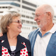 Senior Couple On Shore in Front of Cruise Ship — Stock Photo #4714871