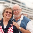 Stock Photo: Senior Couple On Shore in Front of Cruise Ship