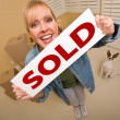 Womand Doggy with Sold Sign Near Moving Boxes — Stock Photo #4756866