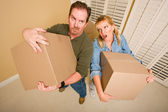 Exhausted Couple Holding Moving Boxes — Stock Photo