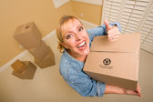 Happy Thumbs Up Woman Moving Boxes — Stock Photo