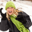 Royalty-Free Stock Photo: Attractive Woman Having Fun in the Snow