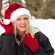 Attractive Santa Hat Wearing Blond Woman Having Fun in Snow — Stock Photo #4772584